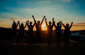 Friends enjoying a sunset together